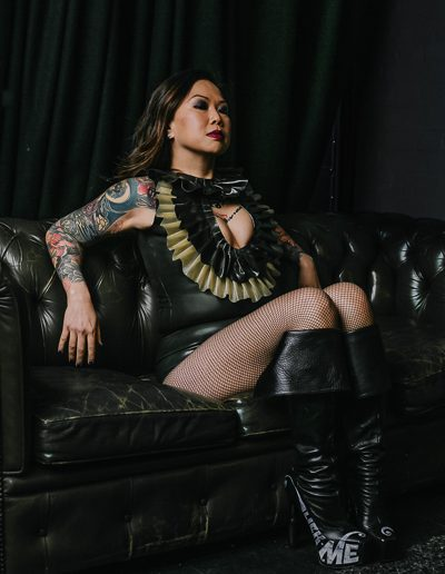 Asian Mistress wearing unusual butt plug boots by Ainsley T