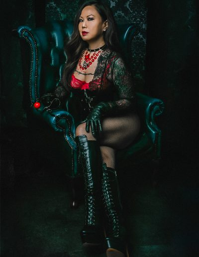 Leather boot and glove fetish dominatrix