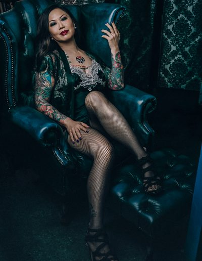 Stunning Asian Mistress wearing fishnet stockings