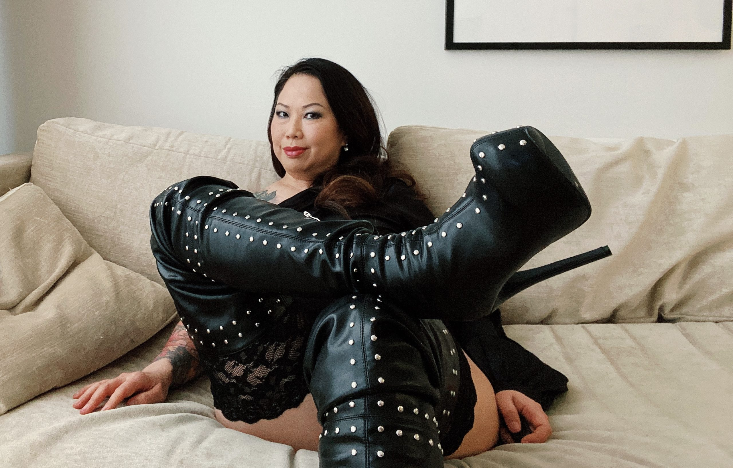 London Asian Dominatrix Madame Li Ying wearing her thigh high leather boots with stiletto heels