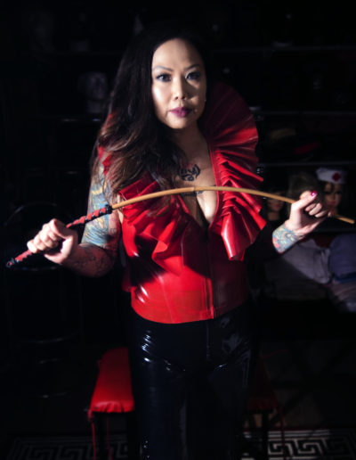 Beautiful Dominant Mistress holding a cane for CP